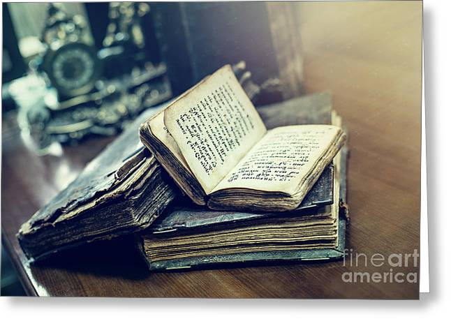 Antique Books With Old Texts Lying On A Table In A Library Greeting Card