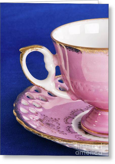 Antique Pink Cup And Saucer On Blue Textured Background Greeting Card by Vizual Studio