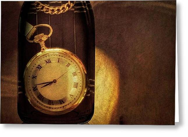 Antique Pocket Watch In A Bottle Greeting Card by Susan Candelario
