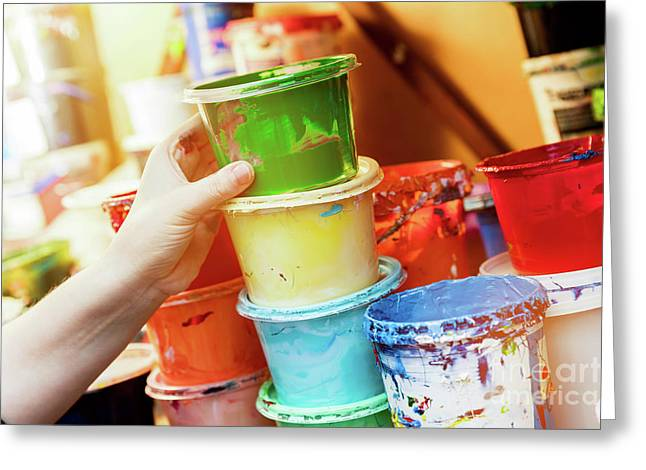 Artist Reaching For A Liquid Paint Container. Greeting Card by Michal Bednarek