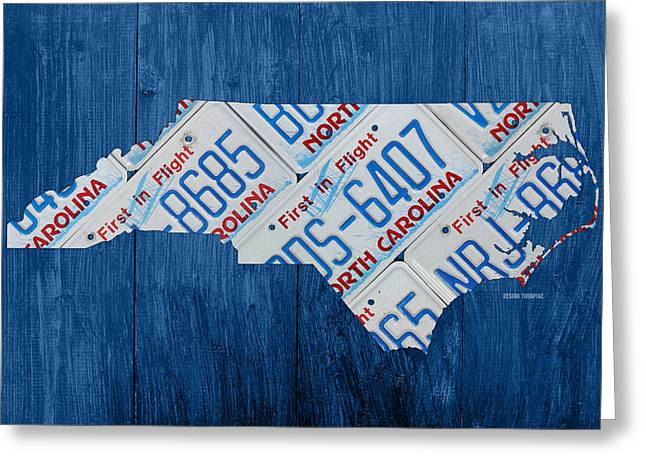 North Carolina Vintage Recycled License Plate Map On Blue Wood Plank Background Greeting Card by Design Turnpike