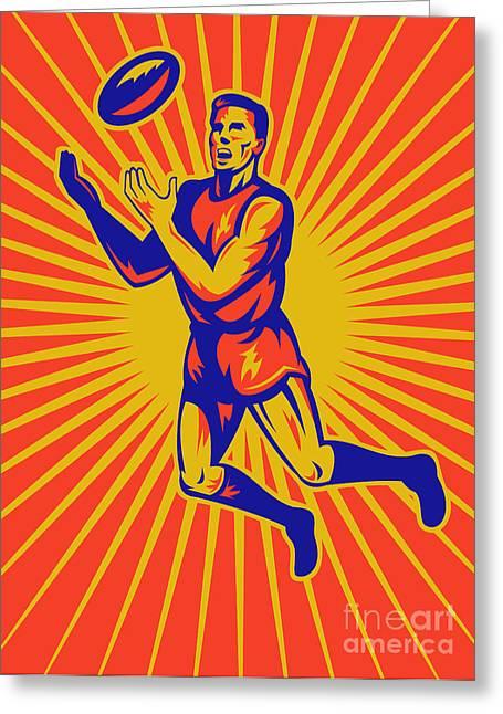 Aussie Rules Player Jumping Ball Greeting Card by Aloysius Patrimonio