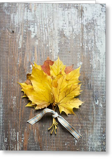 Autumn Leaves Tied With Ribbon Greeting Card