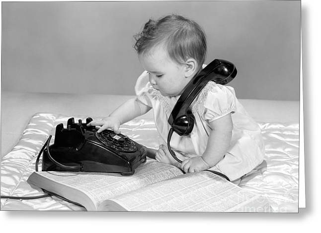 Baby With Phonebook And Phone, 1960s Greeting Card by H. Armstrong Roberts/ClassicStock