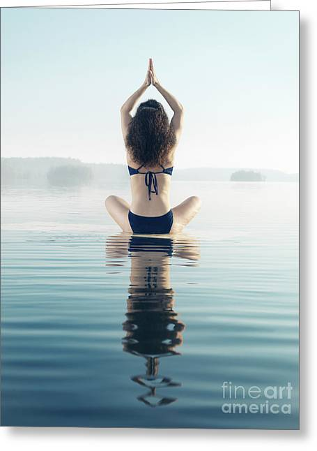 Back Of A Woman Practicing Yoga Meditation On The Water In Sunri Greeting Card