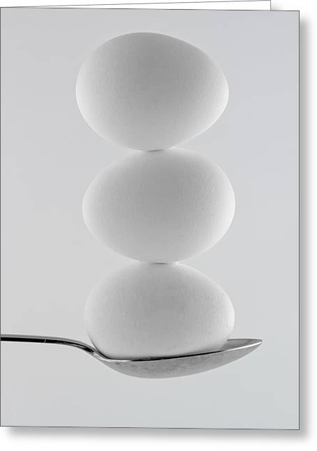 Balancing Eggs Greeting Card by Gert Lavsen