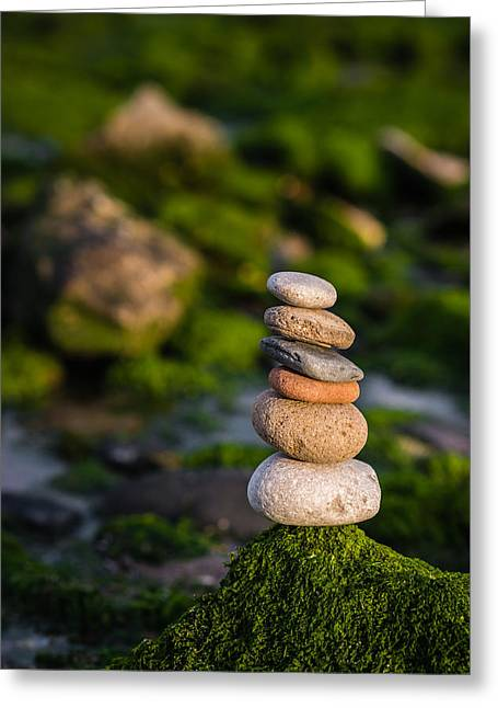 Balancing Zen Stones By The Sea Greeting Card by Marco Oliveira