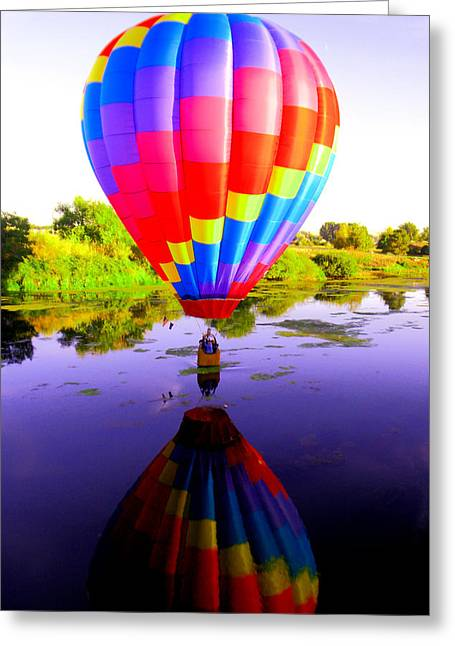 Balloon Touching The Water Greeting Card by Jeff Swan