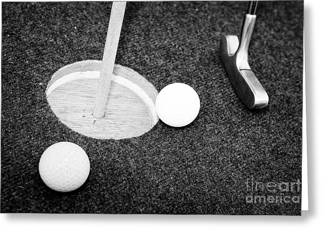 Balls And Golf Putter On Home Made Crazy Golf Hole Greeting Card by Joe Fox