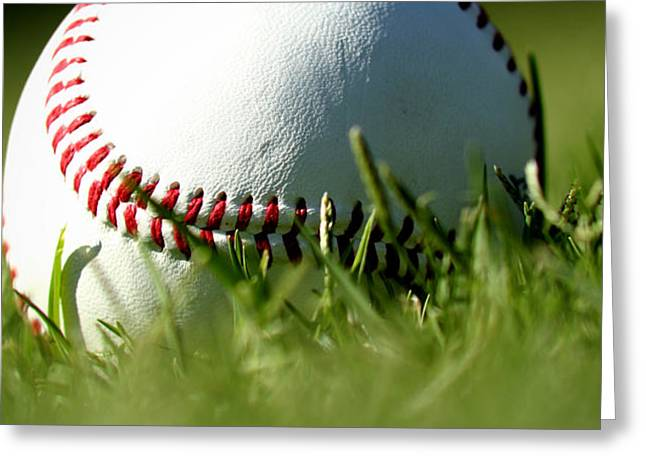 Baseball In Grass Greeting Card by Chris Brannen