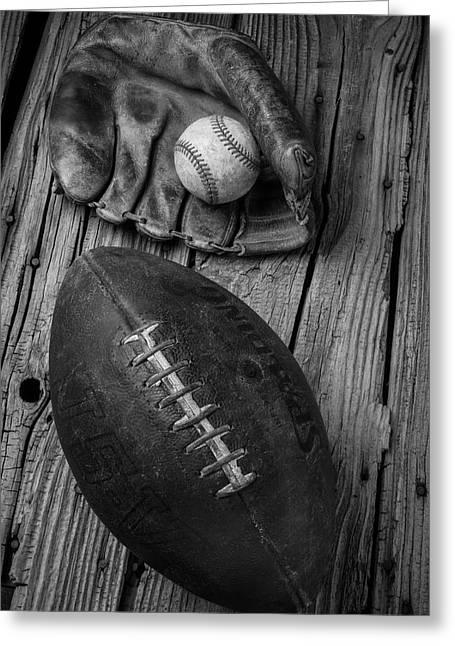 Baseball Mitt And Football Greeting Card by Garry Gay