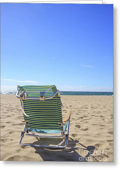 Beach Chair On A Sandy Beach Greeting Card by Edward Fielding
