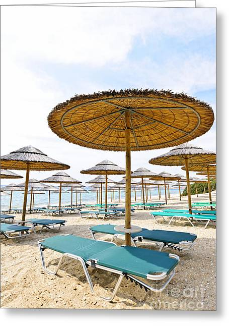 Vacant Greeting Cards - Beach umbrellas and chairs on sandy seashore Greeting Card by Elena Elisseeva