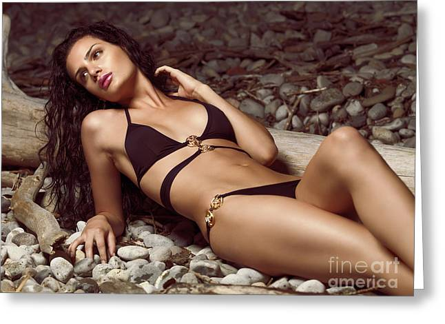 Beautiful Young Woman In Black Bikini On A Pebble Beach Greeting Card