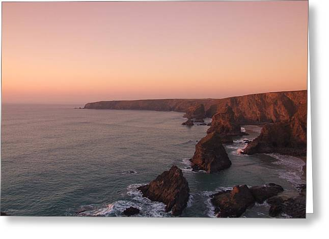 Bedruthan Steps Sunset Greeting Card by Helen Northcott