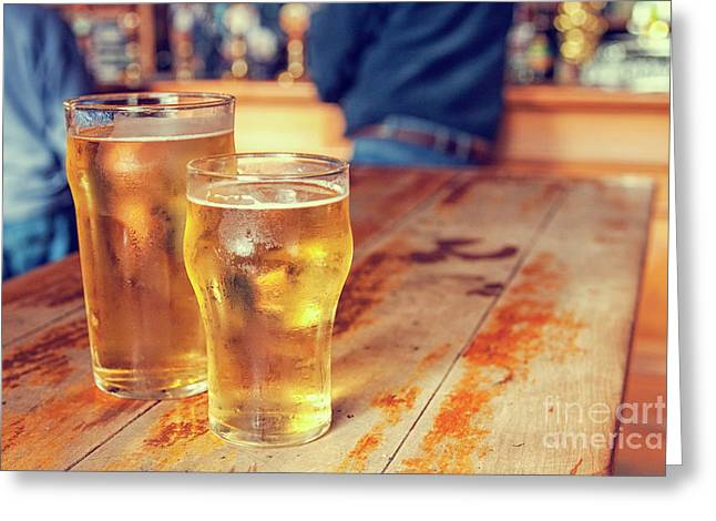 Greeting Card featuring the photograph Beers In A Pub by Patricia Hofmeester