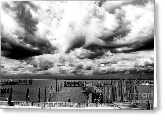 Big Clouds Little Dock Greeting Card by John Rizzuto