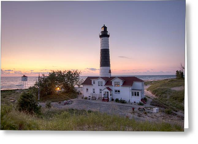 Big Sable Point Lighthouse At Sunset Greeting Card by Adam Romanowicz
