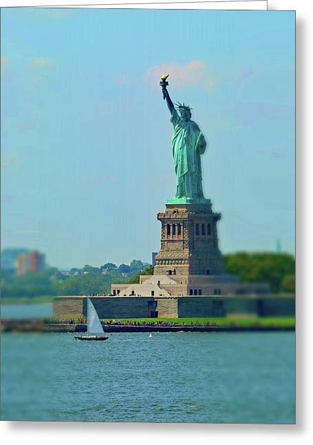 Big Statue, Little Boat Greeting Card by Sandy Taylor