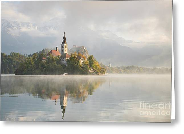 Greeting Card featuring the photograph Bled Lake On A Beautiful Foggy Morning by IPics Photography