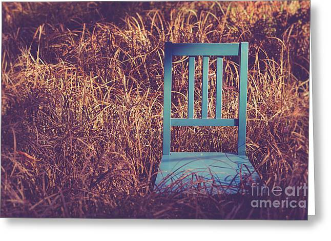 Blue Chair Out In A Field Of Talll Grass Greeting Card