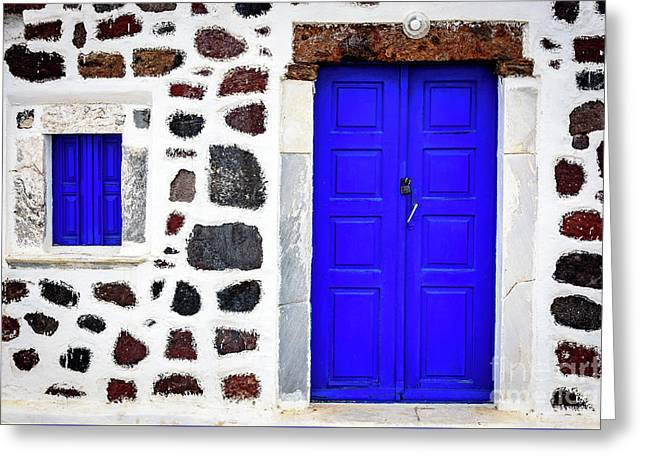 Blue Door Spotted White Building, Santorini, Greece Greeting Card by Global Light Photography - Nicole Leffer