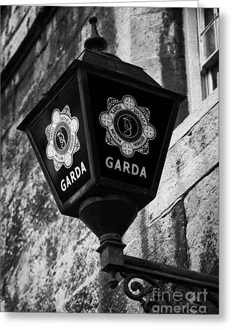 Blue Lamp Above Station Door For The Garda Siochana Na Heireann The Irish Police Force In Dublin Greeting Card by Joe Fox
