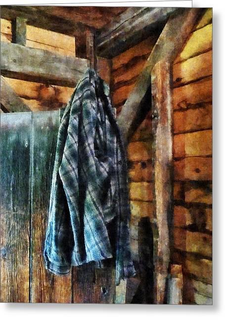 Blue Plaid Jacket In Cabin Greeting Card by Susan Savad