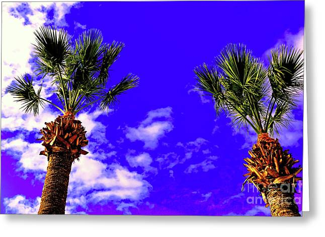 Palms Against Blue Sky Greeting Card by Wilf Doyle