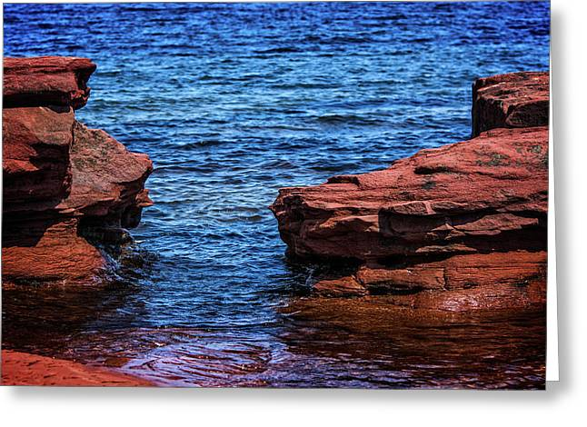 Greeting Card featuring the photograph Blue Water Between Red Stone by Chris Bordeleau