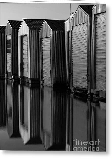 Boat Houses In Rows With Reflections  Greeting Card by Jim Corwin
