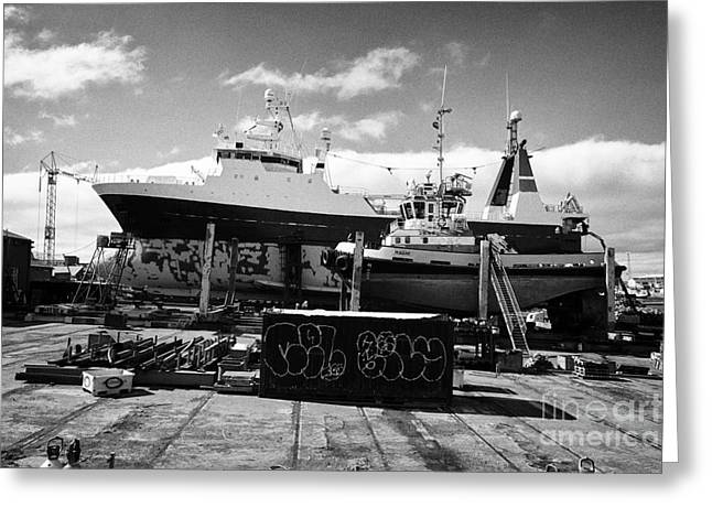 Boats And Ship In Dry Dock In Reykjavik Harbour Iceland Greeting Card