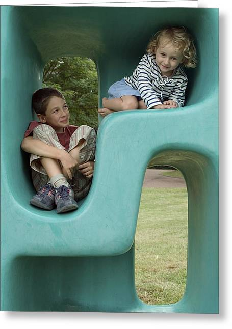 Children Only Greeting Cards - Boy and girl playing in plastic cube Greeting Card by Sami Sarkis
