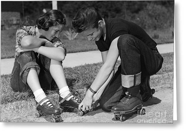 Boy Helping Girl With Roller Skates Greeting Card by H. Armstrong Roberts/ClassicStock