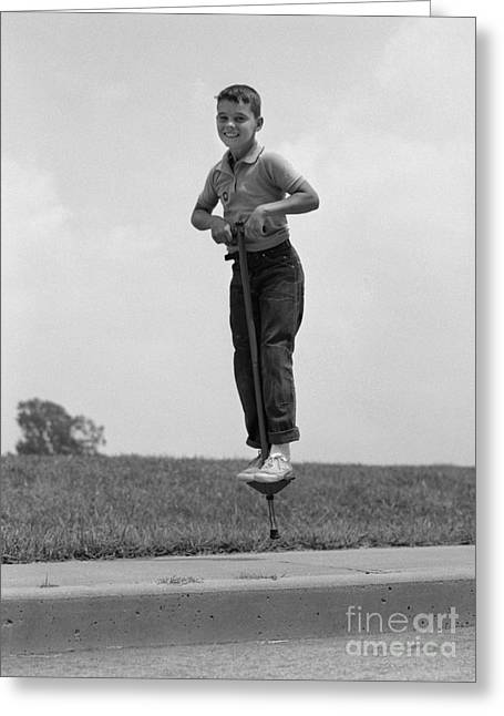 Boy Jumping On Pogo Stick, C.1960s Greeting Card by H. Armstrong Roberts/ClassicStock
