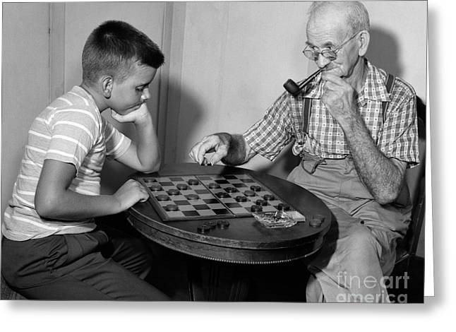 Boy Playing Checkers With Grandfather Greeting Card by Debrocke/ClassicStock