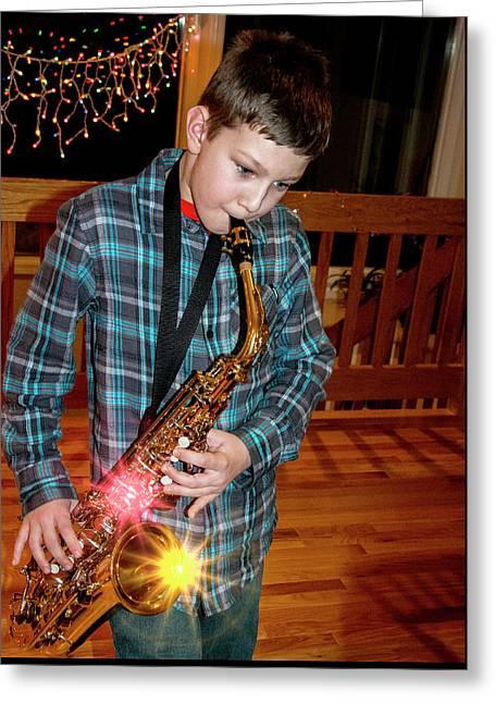 Boy Playing The Saxophone Greeting Card