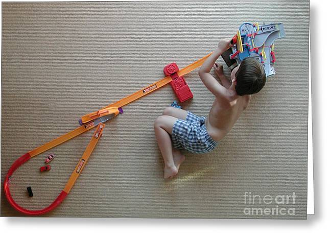 Boy Playing With Toy Cars Greeting Card