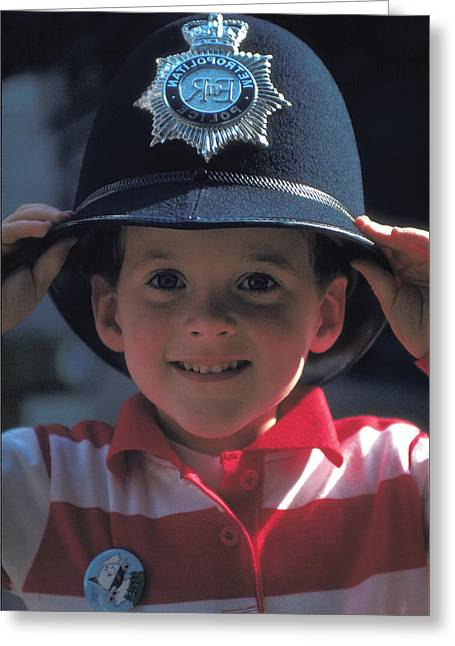 Boy Wears Bobby Hat In London Greeting Card by Carl Purcell