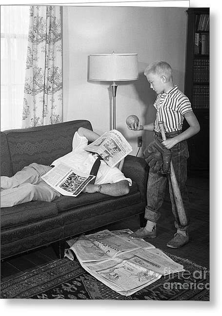 Boy With Baseball Vs. Napping Dad Greeting Card by D. Corson/ClassicStock