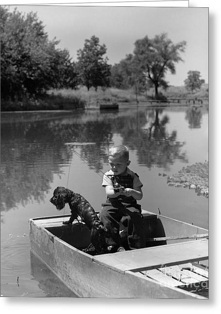 Boy With Dog In Fishing Boat Greeting Card