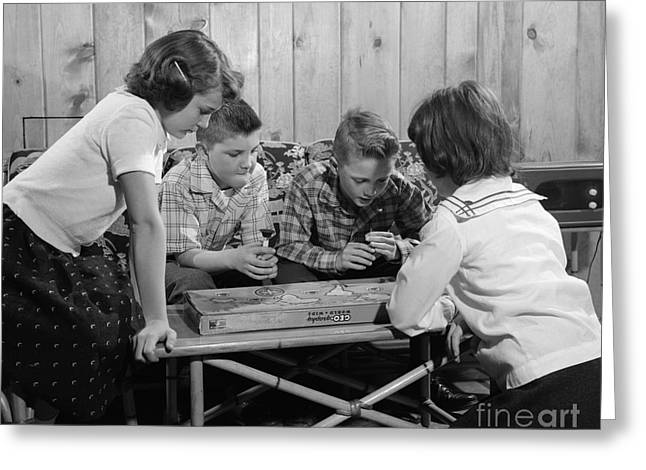 Boys And Girls Playing Board Game Greeting Card by H. Armstrong Roberts/ClassicStock