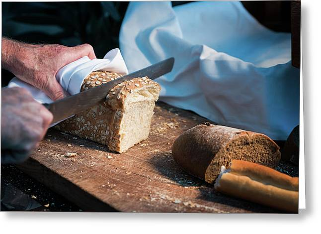 Bread Separate By Knife And Hand Greeting Card by Anek Suwannaphoom