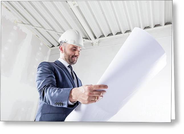 Businessman Analysing Documents At The Construction Site. Greeting Card