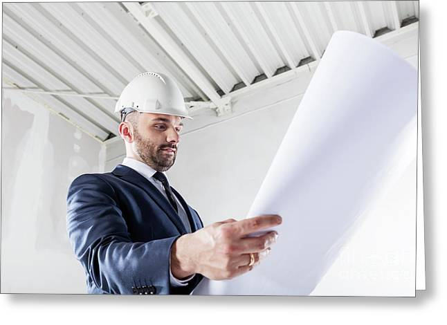 Businessman Checking Documents At The Construction Site. Greeting Card