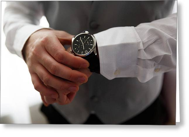 Businessman Looking At His Watch In Office Greeting Card