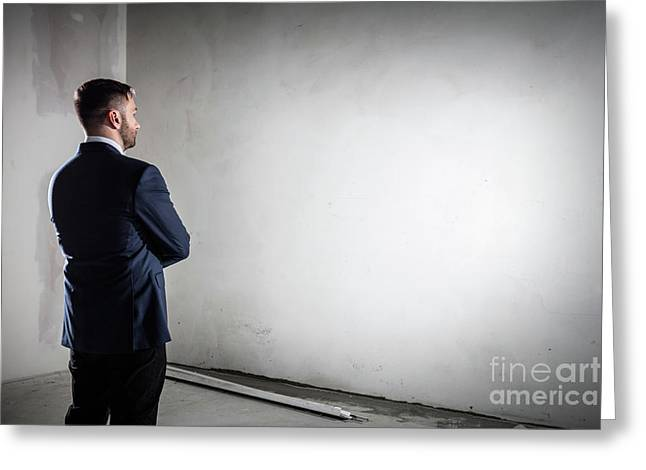 Businessman Standing In An Open Empty Space Indoors And Looking At The Wall. Greeting Card