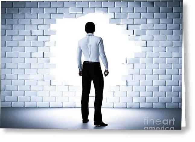 Businessman Standing Next To A Hole In A Brick Wall. Light Coming From Outside Greeting Card