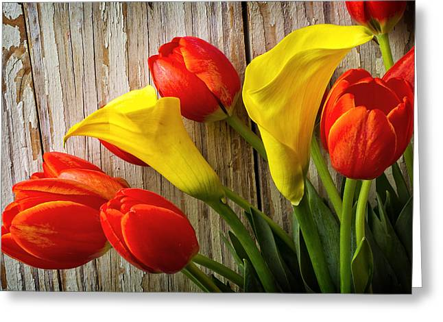 Calla Lilies And Red Tulips Greeting Card by Garry Gay