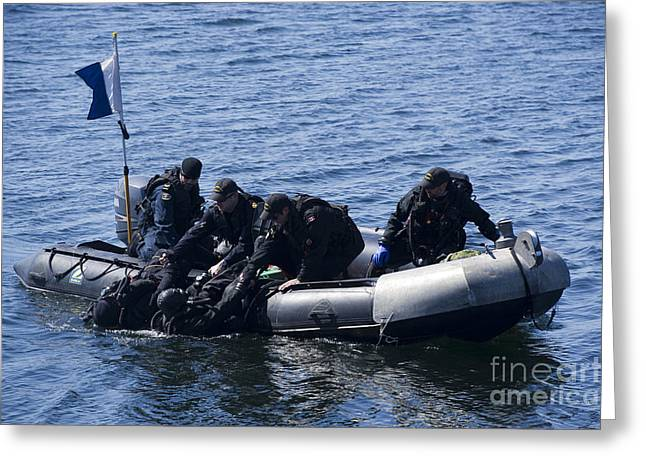 Canadian Divers Being Helped Aboard Greeting Card by Stocktrek Images